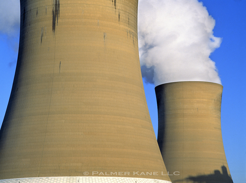 Nuclear Cooling Stacks with steam pouring out. Horizontal.