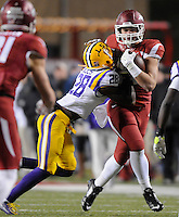NWA Media/ J.T. Wampler -  Arkansas' Hunter Henry tries to shake LSU's Jalen Mills during the third quarter Saturday Nov. 15, 2014 at Donald W. Reynolds Razorback Stadium. Arkansas won 17-0.