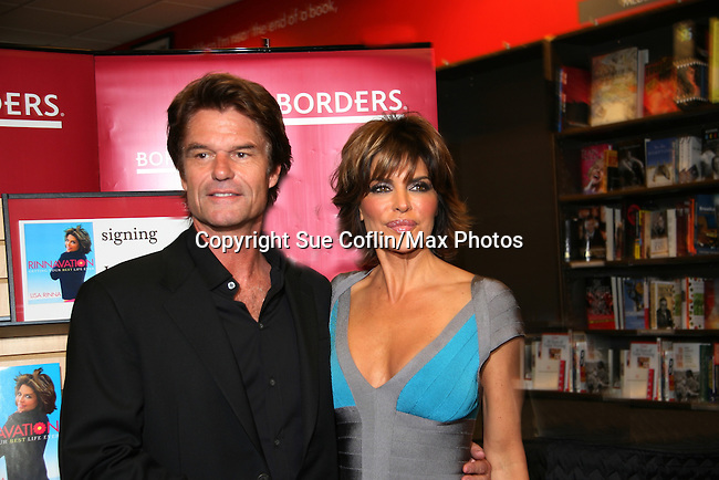 Husband Harry Hamlin poses with Lisa Rinna as her new book Rinnavation - Getting Your Best Life Ever debuts today, May 19. 2009 at Borders at Columbus Circle, New York City, New York. (Photo by Sue Coflin/Max Photos)
