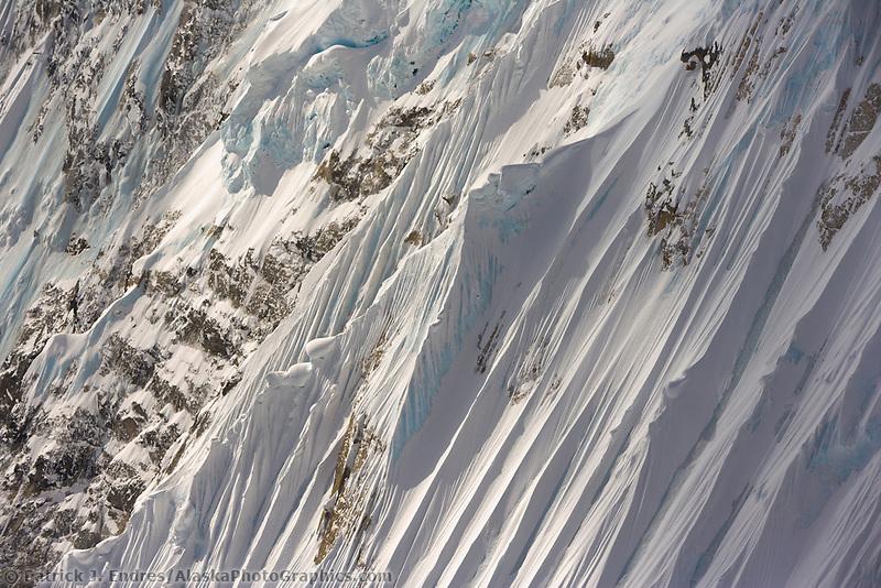 Aerial of steep, fluted mountain ridges surrounding Denali, Denali National Park, Alaska