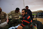 Sirte, LIBYA: Monday 11th October 2011:..A man suspected of being a Gaddafi loyalist soldier is placed on the back of a pickup truck leaving Sirte...Ayman Oghanna