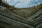 February 15, 2004. Port Au Prince, Haiti. Boat builders shape wooden sailboats for the local population of Haiti.