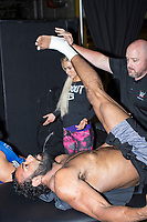 WWE Athletic Trainer Larry Heck stretches the legs of WWE Champion Jinder Mahal before a match as part of the WWE Live Summerslam Heatwave Tour at the MassMutual Center in Springfield, Massachusetts, USA, on Mon., Aug. 14, 2017.