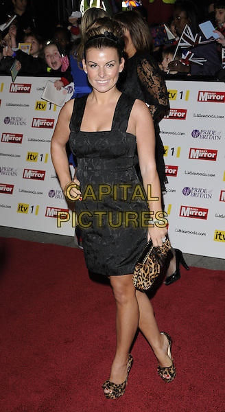 COLEEN ROONEY .Attending the Pride of Britain Awards 2010, Grosvenor House, Park Lane, London, England, UK, .November 8th 2010..arrivals full length black sleeveless straps dress hand on hip hair up bun hairband hair band bow print patterned bracelets diamonds red nails nail varnish polish smiling leopard print animal brown platform shoes clutch bag .CAP/CAN.©Can Nguyen/Capital Pictures.