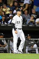 Chicago White Sox manager Robin Ventura (23) walks to the mound to make a pitching change during a game against the Toronto Blue Jays on August 15, 2014 at U.S. Cellular Field in Chicago, Illinois.  Chicago defeated Toronto 11-5.  (Mike Janes/Four Seam Images)