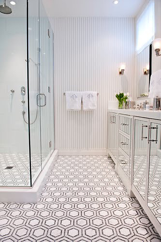 This custom bathroom features Honeycomb, a handmade mosaic shown in polished Thassos, Bardiglio and honed Calacatta from New Ravenna.<br />