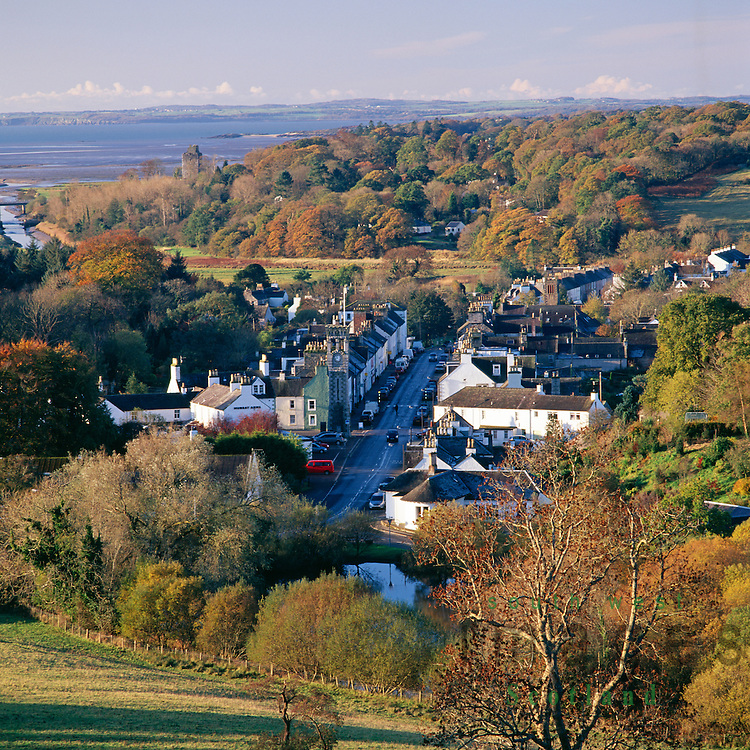 Autumn scenic landscape looking down on the town of Gatehouse of Fleet, Cardoness Castle and across Wigtown Bay to the Machars of Galloway Scotland UK