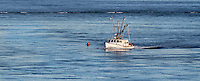 Commercial fishing boat enters Chatham Harbor, Cape Cod, Massachusetts, USA