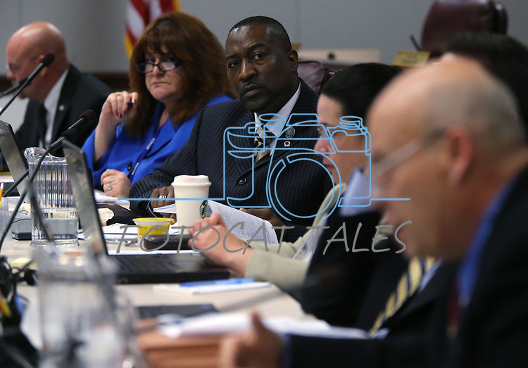 Nevada Assembly members, from left, Ira Hansen, Ellen Spiegel, Tyrone Thompson, Lesley Cohen work in committee at the Legislative Building in Carson City, Nev., on Thursday, May 9, 2013..Photo by Cathleen Allison
