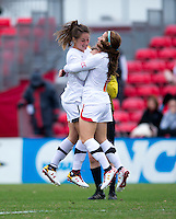 Alex Reed (7) of Maryland celebrates her goal with teammate Danielle Hubka (34) during the game at Ludwig Field in College Park, MD.  Maryland defeated Miami, 2-1, in overtime.