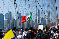People cross the Brooklyn bridge as they attend a rally in support of the Immigrant reform in New York,  Oct 5, 2013, Photo by Eduardo Munoz Alvarez / VIEWpress.