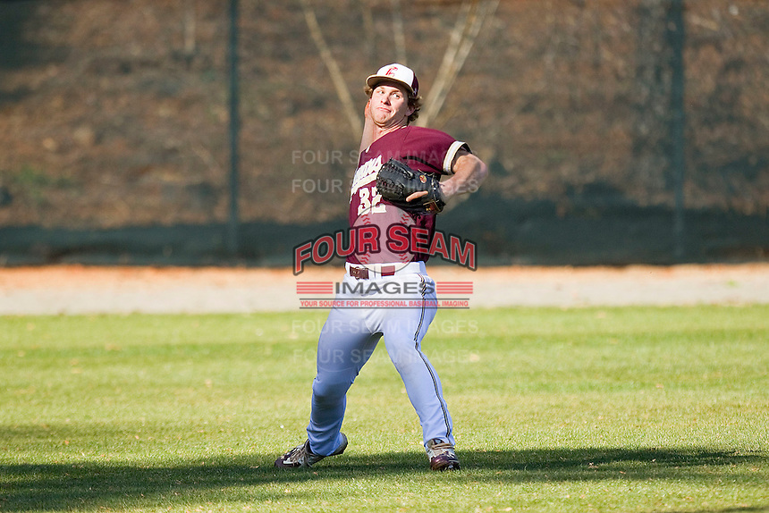 Left fielder Daniel Aldrich #32 of the College of Charleston Cougars makes a throw back to the infield during the game against the Davidson Wildcats at Wilson Field on March 12, 2011 in Davidson, North Carolina.  The Wildcats defeated the Cougars 8-3.  Photo by Brian Westerholt / Four Seam Images