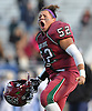 Glen Cove No. 52 Yovanis Galo reacts after his team's 21-0 win over Bethpage in a Nassau County varsity football Conference III semifinal at Hofstra University on Saturday, Nov. 14, 2015.<br /> <br /> James Escher