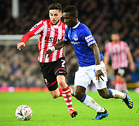 Lincoln City's Tom Pett battles with  Everton's Idrissa Gueye<br /> <br /> Photographer Andrew Vaughan/CameraSport<br /> <br /> Emirates FA Cup Third Round - Everton v Lincoln City - Saturday 5th January 2019 - Goodison Park - Liverpool<br />  <br /> World Copyright &copy; 2019 CameraSport. All rights reserved. 43 Linden Ave. Countesthorpe. Leicester. England. LE8 5PG - Tel: +44 (0) 116 277 4147 - admin@camerasport.com - www.camerasport.com