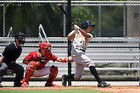 GCL Pirates shortstop Cole Tucker (17) at bat in front of umpire Matt Scott and catcher Joel Fisher during a game against the GCL Phillies on June 26, 2014 at the Carpenter Complex in Clearwater, Florida.  GCL Phillies defeated the GCL Pirates 6-2.  (Mike Janes/Four Seam Images)