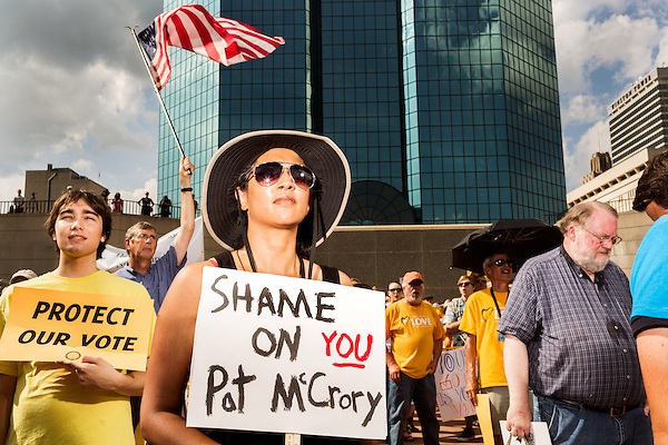 July 13, 2015. Winston Salem, North Carolina.<br />  Sunita Pillay, center, traveled from Asheville to show her support for the NC NAACP's lawsuit against Gov. Pat McCrory.<br />  To rally support for the North Carolina NAACP's case against Gov. Pat McCrory (NC NAACP v. McCrory), a march was held in downtown Winston Salem on the opening day of the case in federal court. Thousands gathered to walk the streets of downtown and listen to speeches proclaiming the importance of defeating new requirements for voter registration,<br />  The NC NAACP contests that HB 589 (Voter ID requirements) violate Section 2 of the Voting Rights Act (42 U.S.C. 1973) and the Fourteenth and Fifteenth Amendments of the Constitution.
