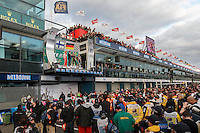 MELBOURNE, 17 MARCH - A view down pit straight showing the podium and crowd at the 2013 Formula One Rolex Australian Grand Prix at the Albert Park Circuit in Melbourne, Australia. Photo Sydney Low/syd-low.com