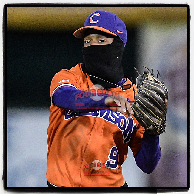 Second baseman Jordan Greene (9) of the Clemson Tigers is bundled up against the 37-degree temperature late in a game against the Furman Paladins on Tuesday, March 5, 2019, at Fluor Field at the West End in Greenville, South Carolina. Clemson won, 3-1. (Tom Priddy/Four Seam Images)