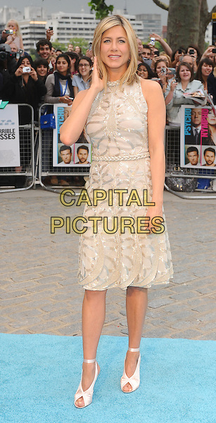 Jennifer Aniston.Horrible Bosses UK Premiere, BFI, London, England..20th July 2011.full length length white cream dress sheer gold folds folded pleats pleated sleeveless braid braided belt sequins sequined ribbon ankle shoes peep toe  hand arm.CAP/BEL.©Tom Belcher/Capital Pictures.