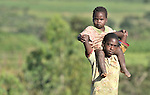 A boy carries his sibling near Kajumi, in northern Malawi.