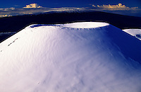 Snow covered cinder cone on the summit of Mauna Kea on the Big Island of Hawaii.