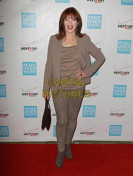 Frances Fisher.41st Annual Peace Over Violence Humanitarian Awards Held At The Beverly Hills Hotel, Beverly Hills, California, USA, 26th October 2012..full length beige jacket top hand on hip jeans  suede grey gray ankle boots .CAP/ADM/KB.©Kevan Brooks/AdMedia/Capital Pictures.