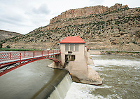 The Grand Valley Diversion Dam along the Colorado River near Grand Junction, Colorado, Sunday, July 5, 2015. The dam is a 14-foot high, 546-foot long concrete roller dam with six gates, which were the first and largest of their kind to be installed in the United States. The dam is primarily used for irrigation for the Grand Valley. <br /> <br /> Photo by Matt Nager
