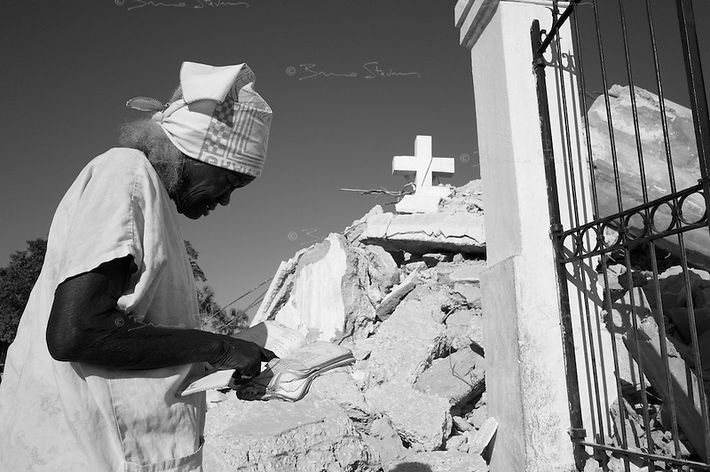 Port Au Prince, Haiti, Jan 17 2010.An old lady comes and pray next to the destroyed Cathedrale Notre-Dame, one of many landmarks lost in the disaster..