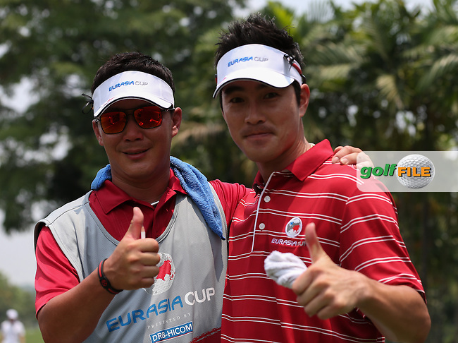 Team Asia's Kim Hyung-sung (KOR) and caddie all smiles as they win their match 4&3 during the second day Foursome matches at the 2014 EurAsia Cup presented by DRB-Hicom, at the Glenmarie Golf & Country Club, Kuala Lumpur, Malaysia. Picture:  David Lloyd / www.golffile.ie