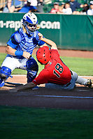 Garrett Hope (44) of the Ogden Raptors applies the tag to a sliding Jonah Todd (18) of the Orem Owlz in Pioneer League action at Lindquist Field on June 22, 2017 in Ogden, Utah. The Owlz defeated the Raptors 13-8.  (Stephen Smith/Four Seam Images)
