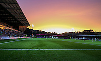 General view of play with the sun setting on Adams Park during the Capital One Cup match between Wycombe Wanderers and Fulham at Adams Park, High Wycombe, England on 11 August 2015. Photo by Andy Rowland.