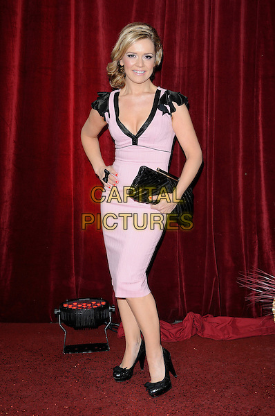 RACHEL LESCOVAC.Attending The British Soap Awards 2010, The London Television Centre, London, England, UK, 8th May 2010 .arrivals full length pink black dress trim shoulders hand on hip clutch bag shoes v-neck bows bow .CAP/CAN.©Can Nguyen/Capital Pictures.