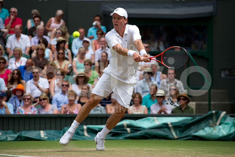 Tomas Berdych (CZE) plays against Novak Djokovic (SRB) on Centre Court. The Wimbledon Championships 2010 The All England Lawn Tennis & Croquet Club  Day 11 Friday 02/07/2010