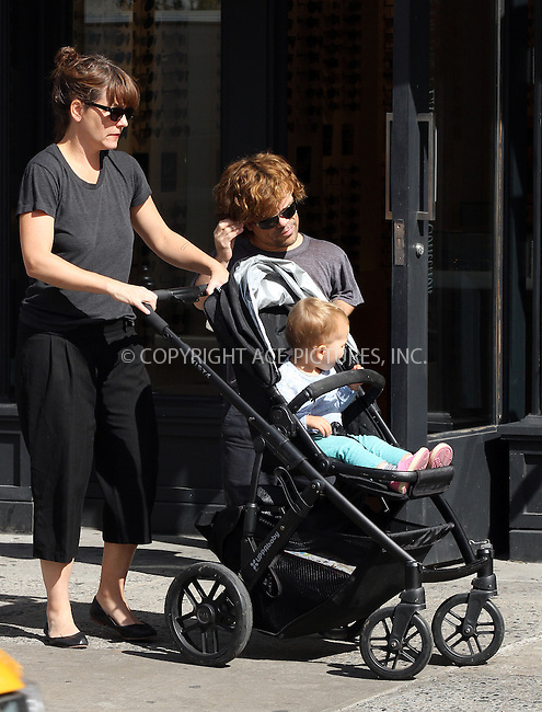 WWW.ACEPIXS.COM<br /> <br /> September 25 2013, New York City<br /> <br /> Actor Peter Dinklage walks with his wife Erica Schmidt and their daughter Zelig on September 25 2013 in New York City<br /> <br /> By Line: Zelig Shaul/ACE Pictures<br /> <br /> <br /> ACE Pictures, Inc.<br /> tel: 646 769 0430<br /> Email: info@acepixs.com<br /> www.acepixs.com