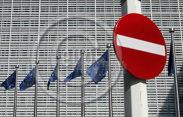 BRUSSELS - BELGIUM - 31 AUGUST 2005 -- Row of EU flags infront of the EU-Commission headquarters building the Berlaymont with traffic sign closed to all vehicles.--  PHOTO: JUHA ROININEN / EUP-IMAGES