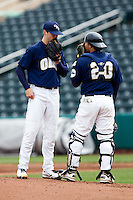Bryce Smolen (44) of the Oral Roberts Golden Eagles has a discussion on the mound with catcher Brett Burch (20) during a game against the Missouri State Bears on March 27, 2011 at Hammons Field in Springfield, Missouri.  Photo By David Welker/Four Seam Images