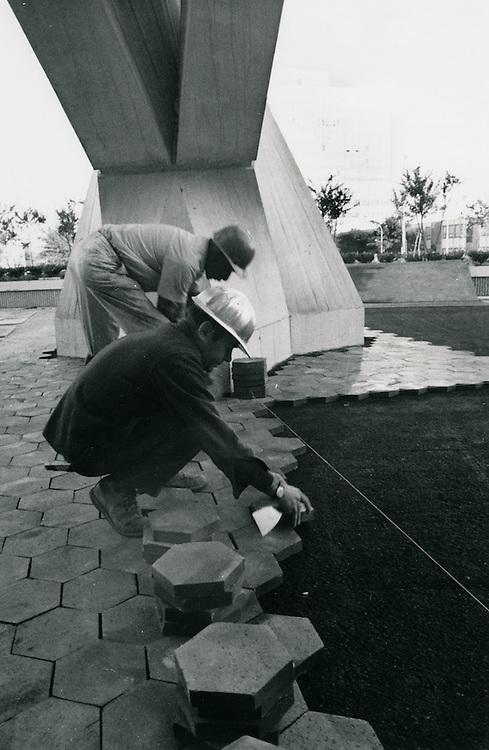 1971 November 05..Redevelopment..Downtown North (R-8)..Paving installation Scope Plaza..Millard Arnold.NEG#..