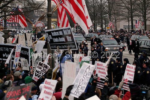 WASHINGTON DC - JANUARY 20: Anti-Bush anti-war protesters on the parade route greet Bush with boos and signs. January 20, 2005 in Washington DC. (photo by Anthony Suau)