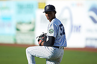 Pulaski Yankees starting pitcher Alexander Vizcaino (57) warms up in the outfield prior to the game against the Greeneville Reds at Calfee Park on June 23, 2018 in Pulaski, Virginia. The Reds defeated the Yankees 6-5.  (Brian Westerholt/Four Seam Images)