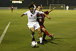 30 June 2004: Philippe Godoy (left) shields Jeff Lochrie (18) from the ball in the second overtime. The Atlanta Silverbacks of the A-League defeated the Carolina Dynamo of the Premier Development League 3-2 in sudden death overtime at McPherson Stadium in Brown's Summit, NC during a third round Lamar Hunt U.S. Open Cup match..