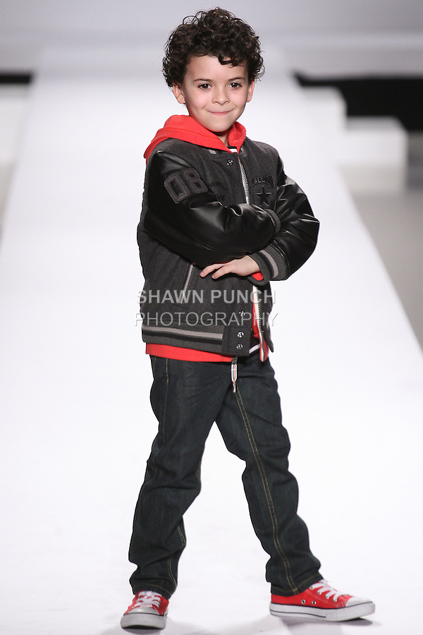 Model walks runway in an outfit from the Converse Fall 2015 collection, during the Kids Rock fashion show presented by Haddad Brands, during Mercedes-Benz Fashion Week Fall 2015.