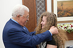Palestinian President Mahmoud Abbas meets with Palestinian activist Ahed Tamimi, in the West Bank city of Ramallah, on July 29, 2018. Photo by Thaer Ganaim