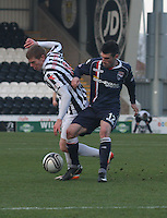 Jon Robertson (left) and Rocco Quinn challenge in the St Mirren v Ross County Clydesdale Bank Scottish Premier League match played at St Mirren Park, Paisley on 19.1.13.