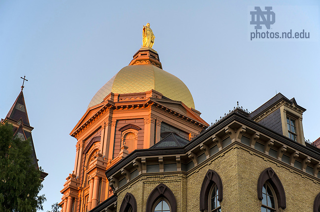 Oct. 8, 2013; Mary statue atop the Main Building at sunset. Photo by Barbara Johnston/University of Notre Dame