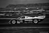DAYTONA BEACH, FL: The Holbert Racing Porsche 962 103 of Al Unser, Jr., Derek Bell and Al Holbert is driven on the infield road course early in the evening during the 24 Hours of Daytona on February 3, 1985, at the Daytona International Speedway. (Photo by Bob Harmeyer)