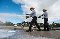 NWA Democrat-Gazette/ANTHONY REYES &bull; @NWATONYR<br /> Cody Keller (left) and Brandon Rochelle, both with the Springdale Fire Department, get a little practice Wednesday, Nov. 4, 2015 using a foam spray system on a paved lot owned by the Springdale Water Department off Silent Grove Road in Springdale. The Compressed Air Foam System or CAFS uses a mix of water, air and foam to fight fires and protect unburned areas. CAFS uses less water but still provides effective fire protection. It also cools the area faster than with water alone. So far four vehicles with the department are equipped with the new system.