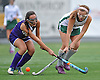 Carle Place No. 6 Kaelin O'Brien, right, makes a pass under pressured from Oyster Bay No. 4 Sarah Collette during the Nassau County varsity field hockey Class C final at Adelphi University on Sunday, November 1, 2015. Carle Place won by a score of 5-0.<br /> <br /> James Escher