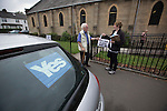 A voter arriving at a polling station in Cardonald, Glasgow on the day of the independence referendum. Yes Scotland were campaigning for the country to leave the United Kingdom, whilst Better Together were campaigning for Scotland to remain in the UK. On the 18th of September 2014, the people of Scotland voted in a referendum to decide whether the country's union with England should continue or Scotland should become an independent nation once again and leave the United Kingdom.