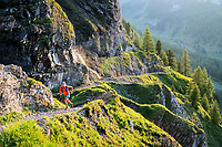 A trail running tour from Iffigenalp, near Lenk, Switzerland that crosses into the Valais before returning. A runner passes Iffigfall.