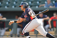 Catcher Carlos Martinez (4) of the Rome Braves bats in game one of a doubleheader against the Columbia Fireflies on Saturday, August 19, 2017, at Spirit Communications Park in Columbia, South Carolina. Rome won, 8-2. (Tom Priddy/Four Seam Images)